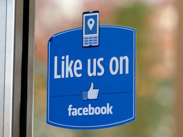 A Dec. 13, 2011 file photo, shows a sign posted at Facebook headquarters near Facebook's User Operations Safety Team workers office in Menlo Park, Calif. The