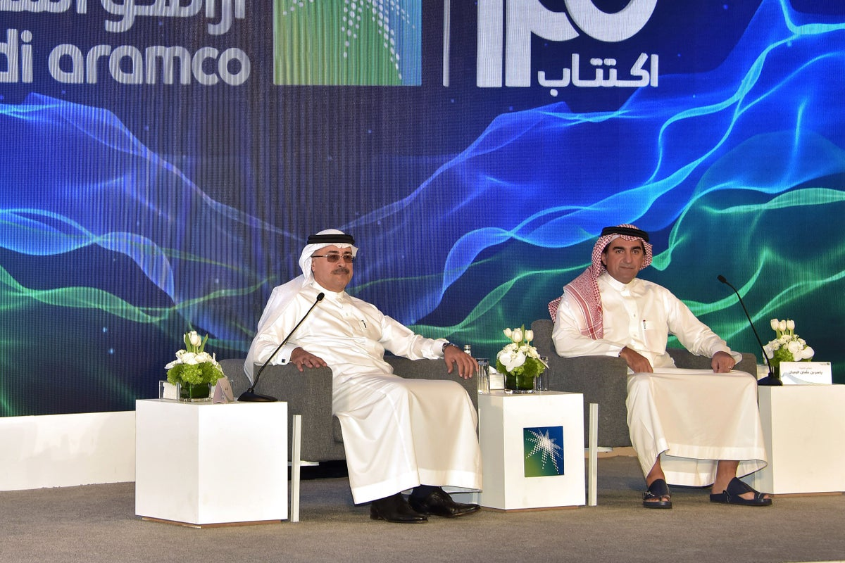 <i>Saudi Aramco's President and CEO Amin Nasser (L) and Chairman Yasir al-Rumayyan (R) at a press conference in Dhahran, Saudi Arabia on Sunday. Photo Credit: EPA-EFE/Shutterstock</i>