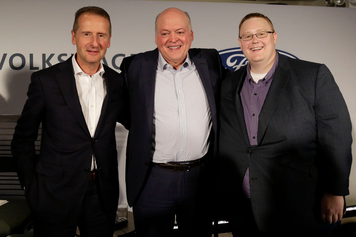 <i>Argo AI CEO and co-founder Bryan Salesky, right, Ford CEO Jim Hackett, center, and Volkswagen CEO Herbert Diess after a news conference in New York on Friday. (Photo Credit: Seth Wenig/AP/Shutterstock)</i>