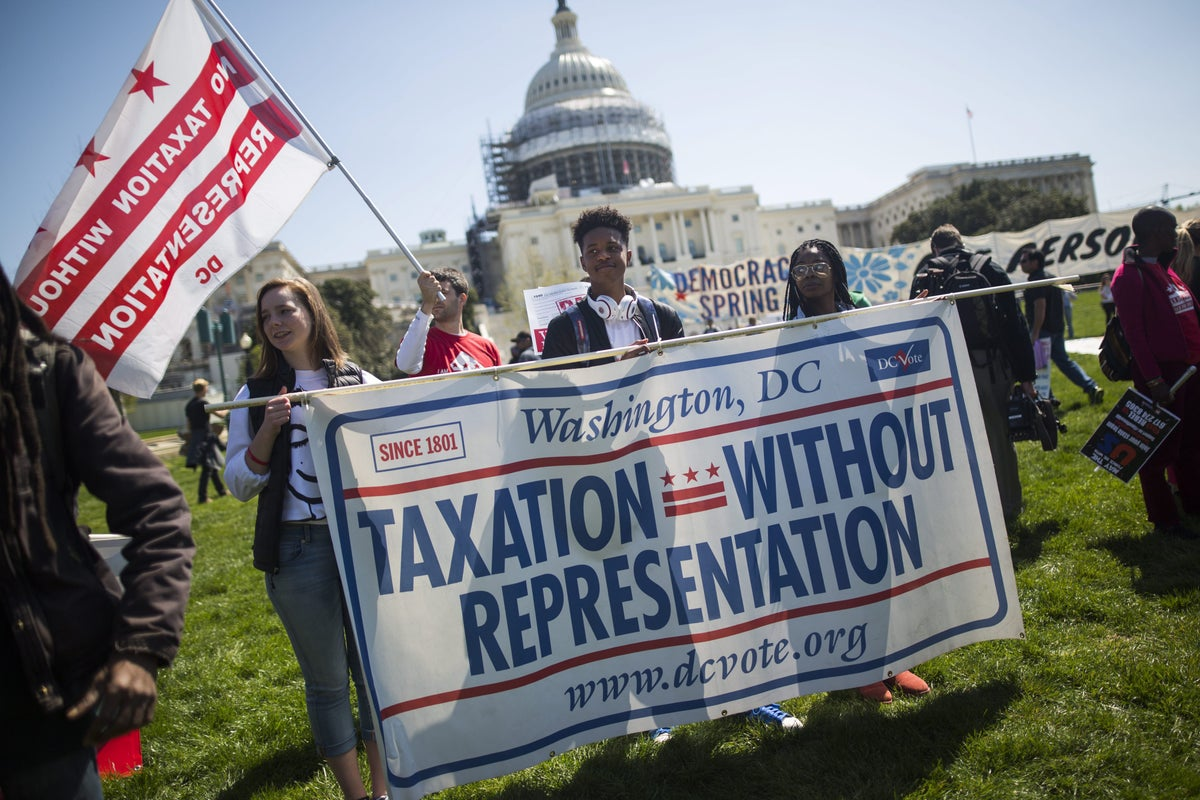 <i>Supporters of DC statehood rally in front of the U.S. Capitol in April 2016. Photo Credit: Jim Lo Scalzo/EPA/Shutterstock</i>
