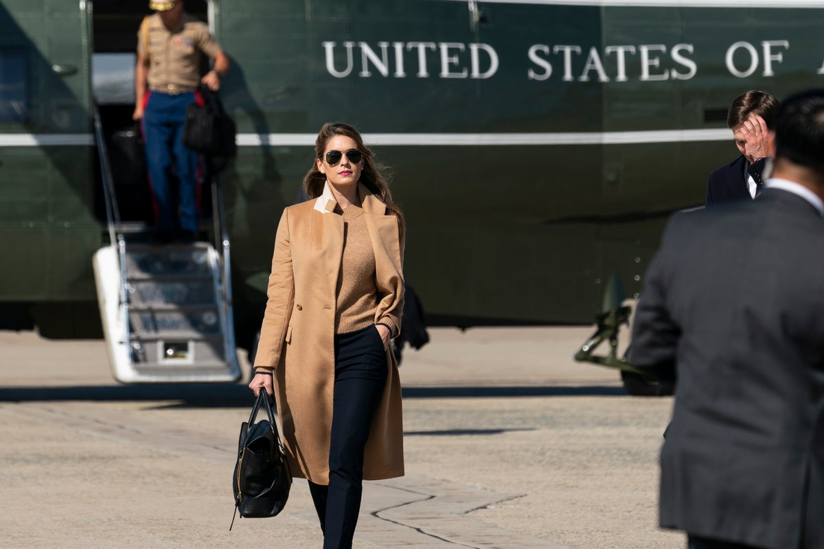 Counselor to the President Hope Hicks walks from Marine One to accompany President Donald Trump aboard Air Force One as he departs Wednesday, Sept. 30, 2020, at Andrews Air Force Base, Md.(AP Photo/Alex Brandon)