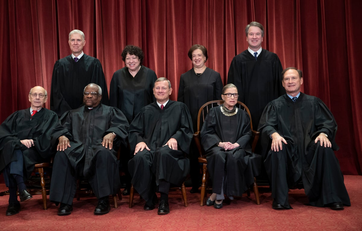 In this file photo from Friday, Nov. 30, 2018, the justices of the U.S. Supreme Court gather for a formal group portrait to include new Associate Justice, top row, far right, at the Supreme Court Building in Washington, Friday, Nov. 30, 2018.Seated from left: Associate Justice Stephen Breyer, Associate Justice Clarence Thomas, Chief Justice of the United States John G. Roberts, Associate Justice Ruth Bader Ginsburg and Associate Justice Samuel Alito Jr. Standing behind from left: Associate Justice Neil Gorsuch, Associate Justice Sonia Sotomayor, Associate Justice Elena Kagan and Associate Justice Brett M. Kavanaugh. (AP Photo/J. Scott Applewhite, file)