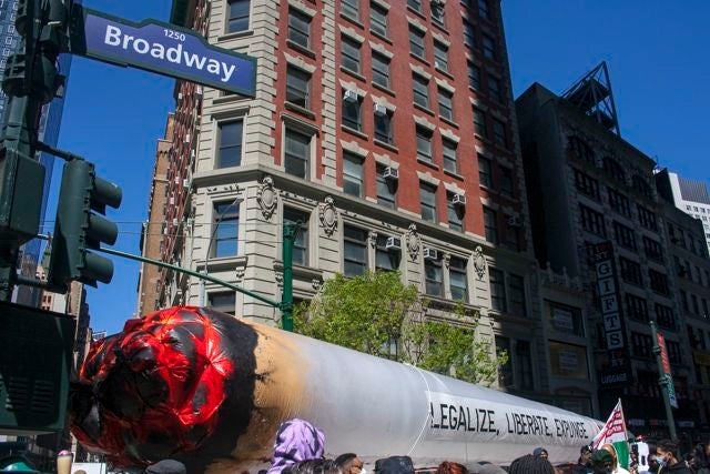 Marchers carry a giant, inflatable joint down Broadway. (Chloe Aiello/Cheddar)