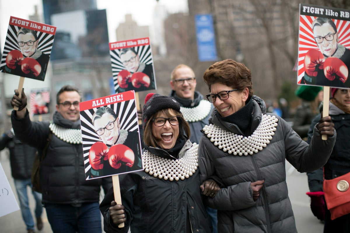 Supporters of Justice Ruth Bader Ginsburg march in during the Women's March Alliance, Saturday, Jan. 19, 2019, in New York.(AP Photo/Mary Altaffer)