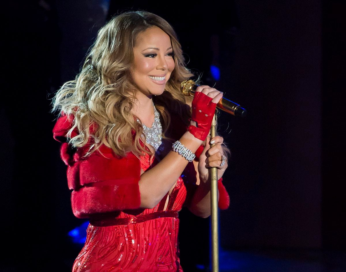 In this Dec. 3, 2014 file photo, Mariah Carey performs at the 82nd Annual Rockefeller Center Christmas tree lighting ceremony in New York.(Photo by Charles Sykes/Invision/AP, File)