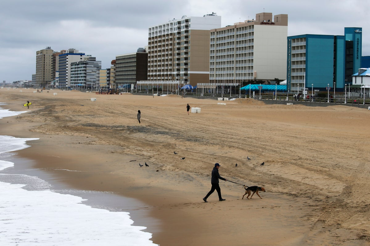 Windy and cool conditions did not attract many visitors to the beach Saturday, April 4, 2020, in Virginia Beach, Va. Activity on the state's beaches last weekend prompted Virginia Gov. Ralph Northam to issue more stringent stay at home guidelines (AP Photo/Steve Helber)