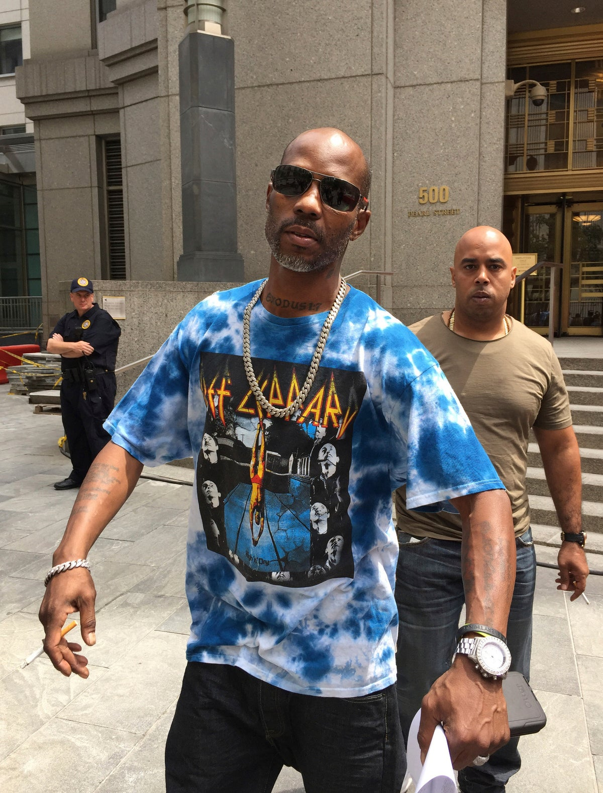 In this August 2017 photo, DMX, the rapper also known as Earl Simmons, has a cigarette after leaving Manhattan federal court in New York following an appearance in his tax fraud case. (AP Photo/Larry Neumeister)