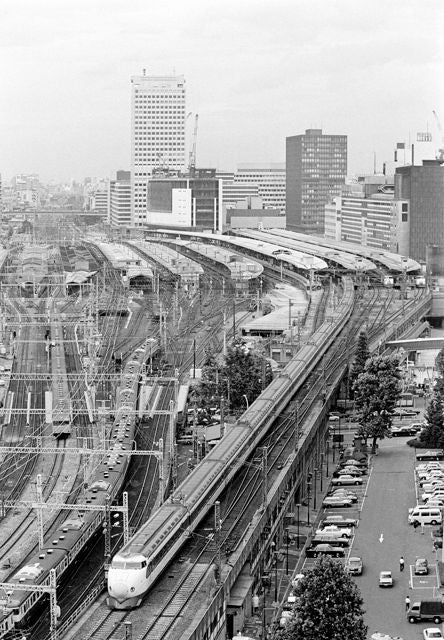 In this June 21, 1978 file photo, Japan's high-speed train called Shinkansen, right, leaves Tokyo Station with two other Shinkansen trains, top right, are at the terminal ready to go while commuter trains, left, head into the station. Zipping cross-country in a super-high-speed train has become commonplace in many countries these days, but it was unheard of when Japan launched its bullet train between Tokyo and Osaka 50 years ago Wednesday, Oct. 1, 2014. (AP Photo/File)