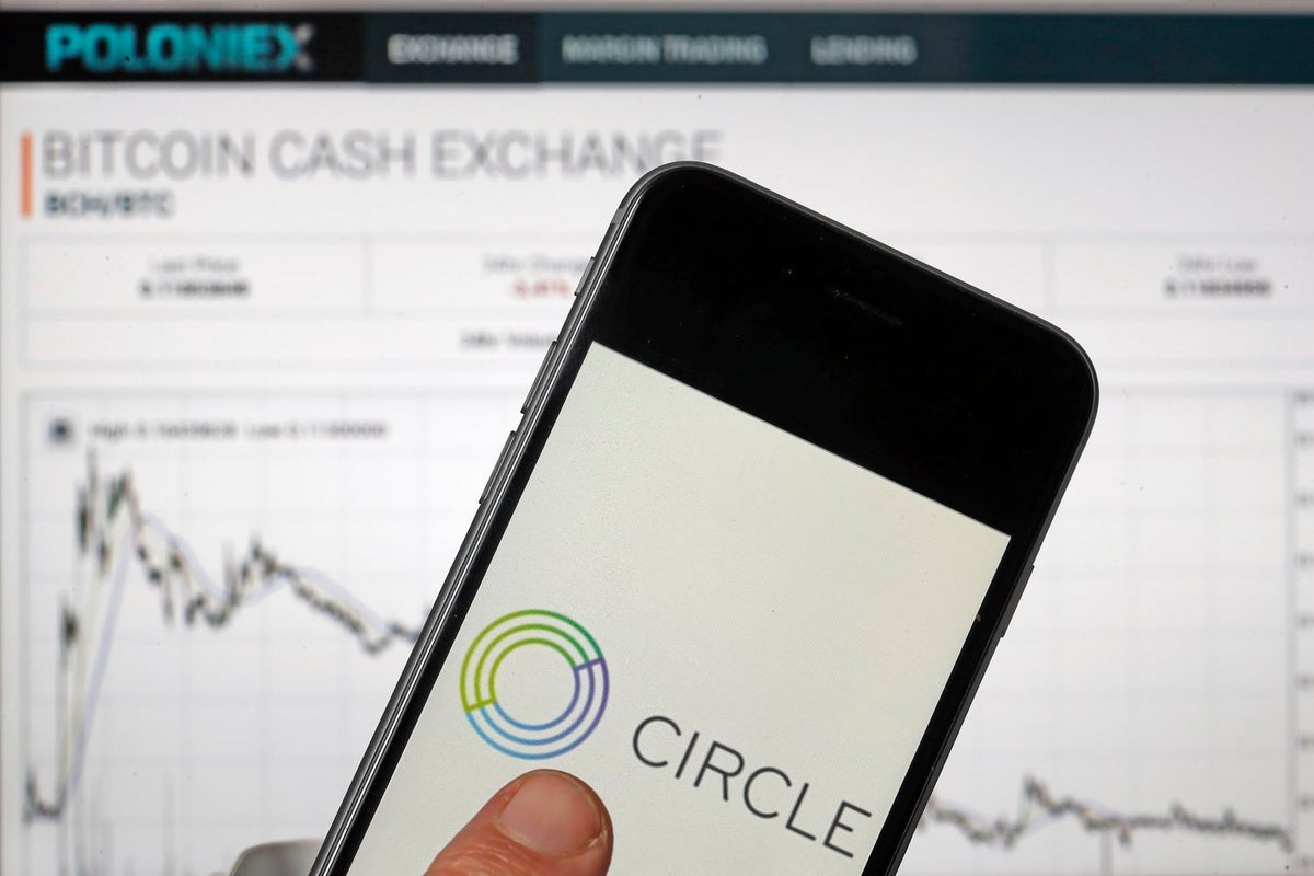 In this photo illustration, US mobile payment company Circle application is seen on the screen of an iPhone in front of the Poloniex cryptocurrency exchange website on February 27, 2018 in Paris, France. (Photo Illustration by Chesnot/Getty Images)