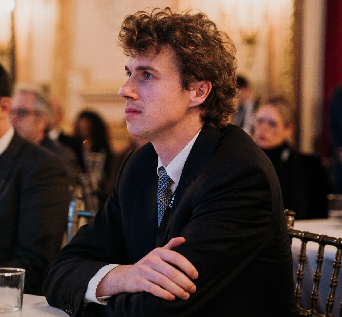 <i>NOBL Group CEO Stephen Murphy listens to a panel at the Metropolitan Club. / Photo Credit: Timothy Smith</i>