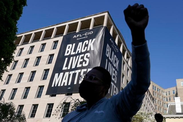 A person reacts on Tuesday, April 20, 2021, in Washington, at Black Lives Matter Plaza near the White House after the verdict in Minneapolis, in the murder trial against former Minneapolis police officer Derek Chauvin was announced. (AP Photo/Alex Brandon)