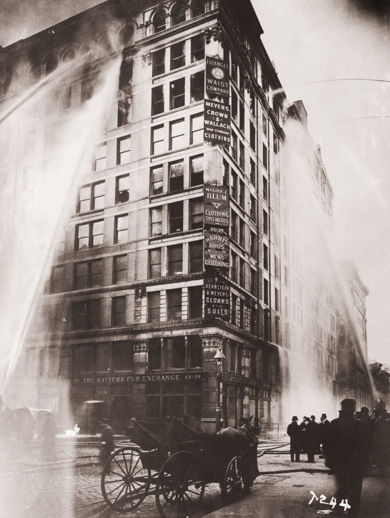Fire hoses spray water on the upper floors of the Asch Building (housing the Triangle Shirtwaist Company) on Washington and Greene Streets, during the fire in New York City, March 25, 1911. (Photo by Keystone/Getty Images)