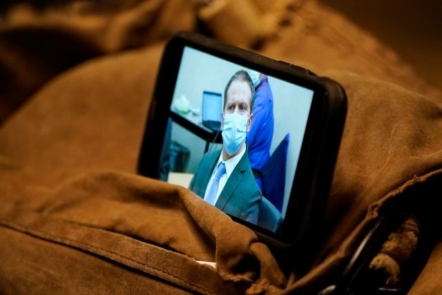 A video screen displaying former Minneapolis police Officer Derek Chauvin is seen as the jury afirms a guilty verdict at the trial of Chauvin for the 2020 death of George Floyd, Tuesday, April 20, 2021, in Minneapolis, Minn. Former Minneapolis police Officer Derek Chauvin has been convicted of murder and manslaughter in the death of Floyd. (AP Photo/Julio Cortez)
