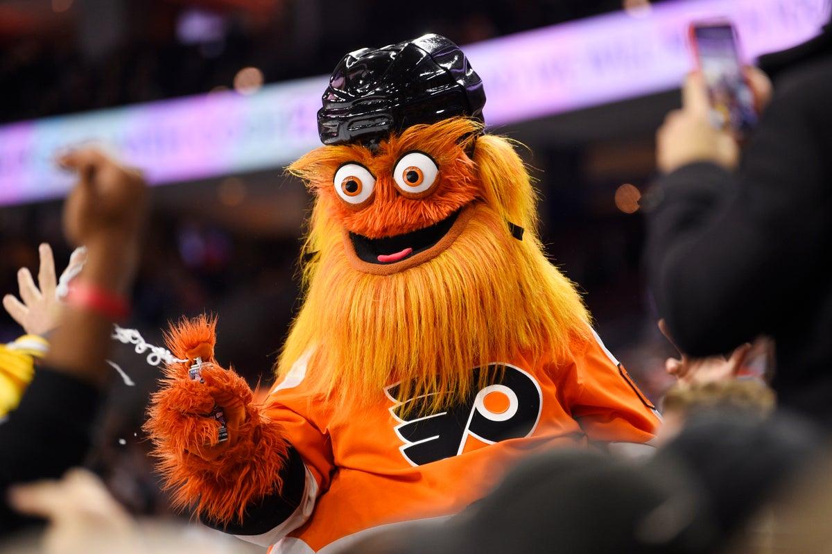 n this Monday, Jan. 13, 2020, file photo, Philadelphia Flyers' mascot Gritty performs during an NHL hockey game in Philadelphia. (AP Photo/Derik Hamilton, File)