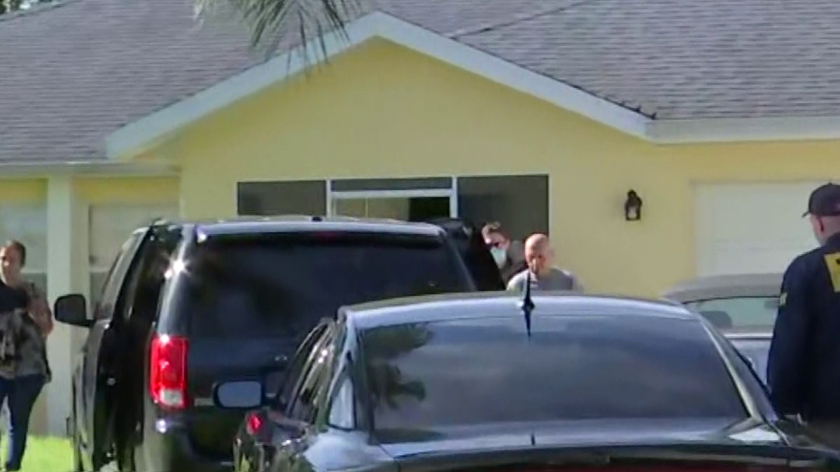 Brian Laundrie's dad being placed in a vehicle by the FBI. Courtesy: WINK