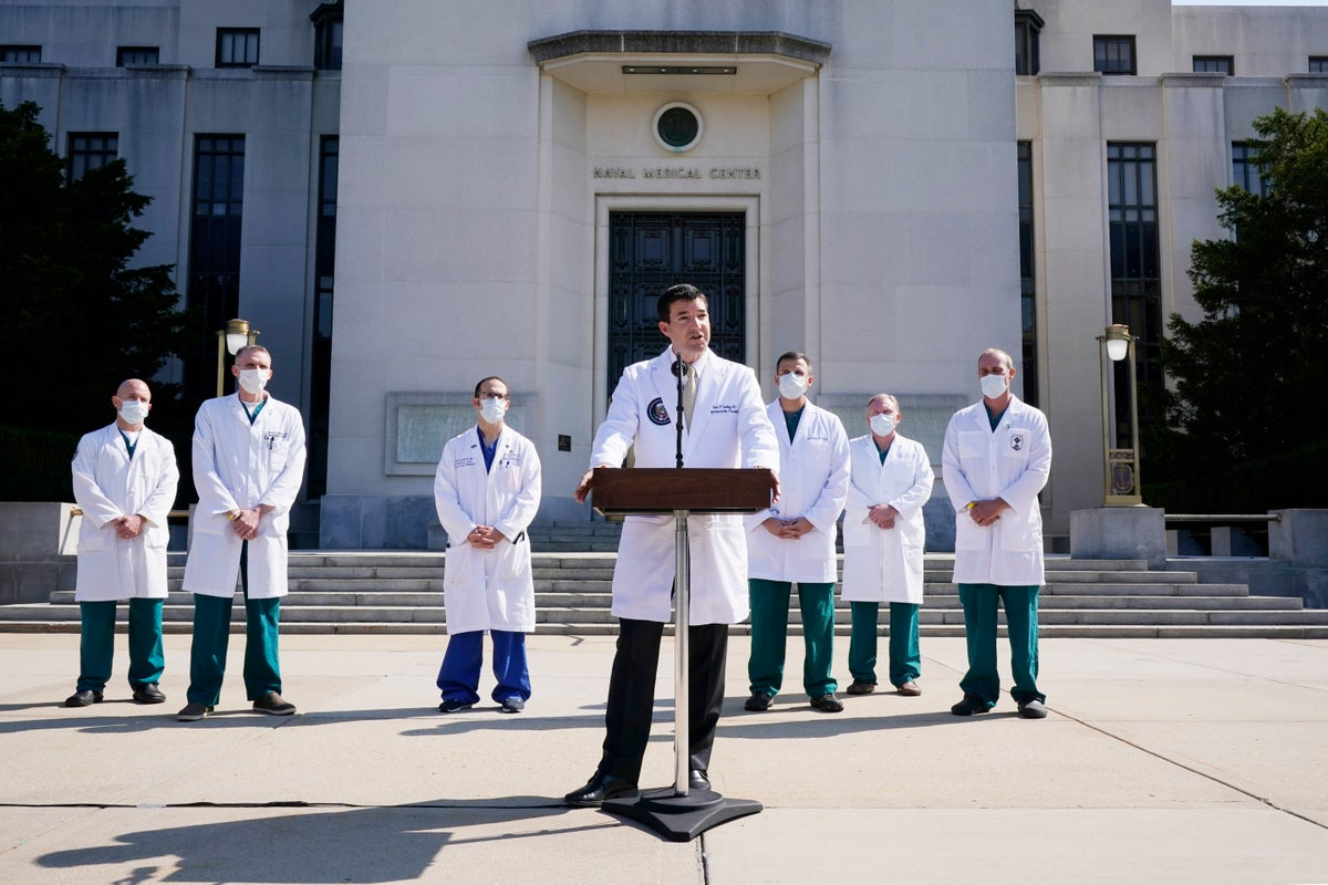 Dr. Sean Conley, physician to President Donald Trump, briefs reporters at Walter Reed National Military Medical Center in Bethesda, Md., Sunday, Oct. 4, 2020. (AP Photo/Jacquelyn Martin)