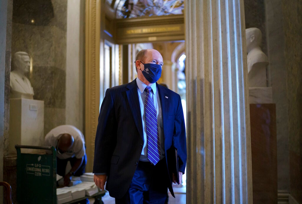 Sen. Chris Coons, D-Del., a friend and ally of President Joe Biden, leaves the chamber as lawmakers work to advance the $1 trillion bipartisan infrastructure bill, at the Capitol in Washington, Tuesday, Aug. 3, 2021. (AP Photo/J. Scott Applewhite)