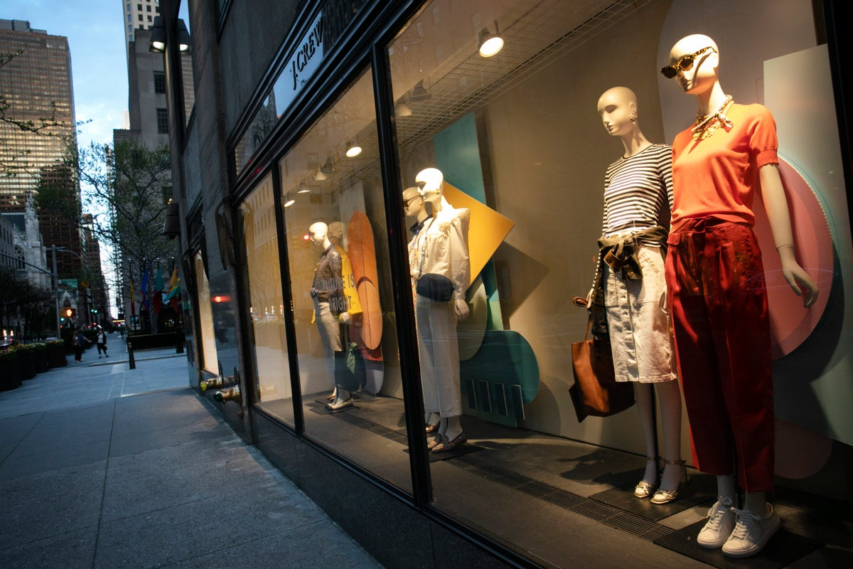 A window display at a J Crew store overlooks a quiet Rockefeller Center, Saturday, May 2, 2020, in New York. On April 30, the company announced it would apply for bankruptcy protection amidst the COVID-19 pandemic. (AP Photo/Mark Lennihan)