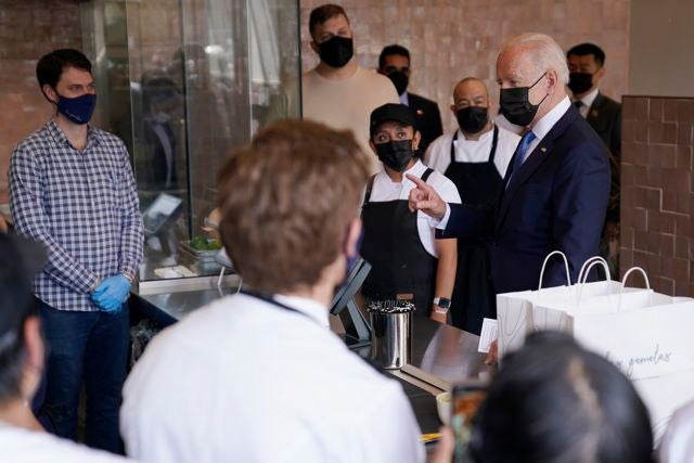 President Joe Biden talks with employees during a visit to Taqueria Las Gemelas restaurant Wednesday, May 5, 2021, in Washington. (AP Photo/Evan Vucci)