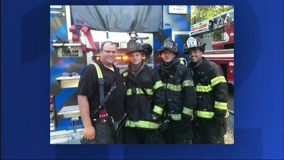 Lloyd (right) with volunteer firemen