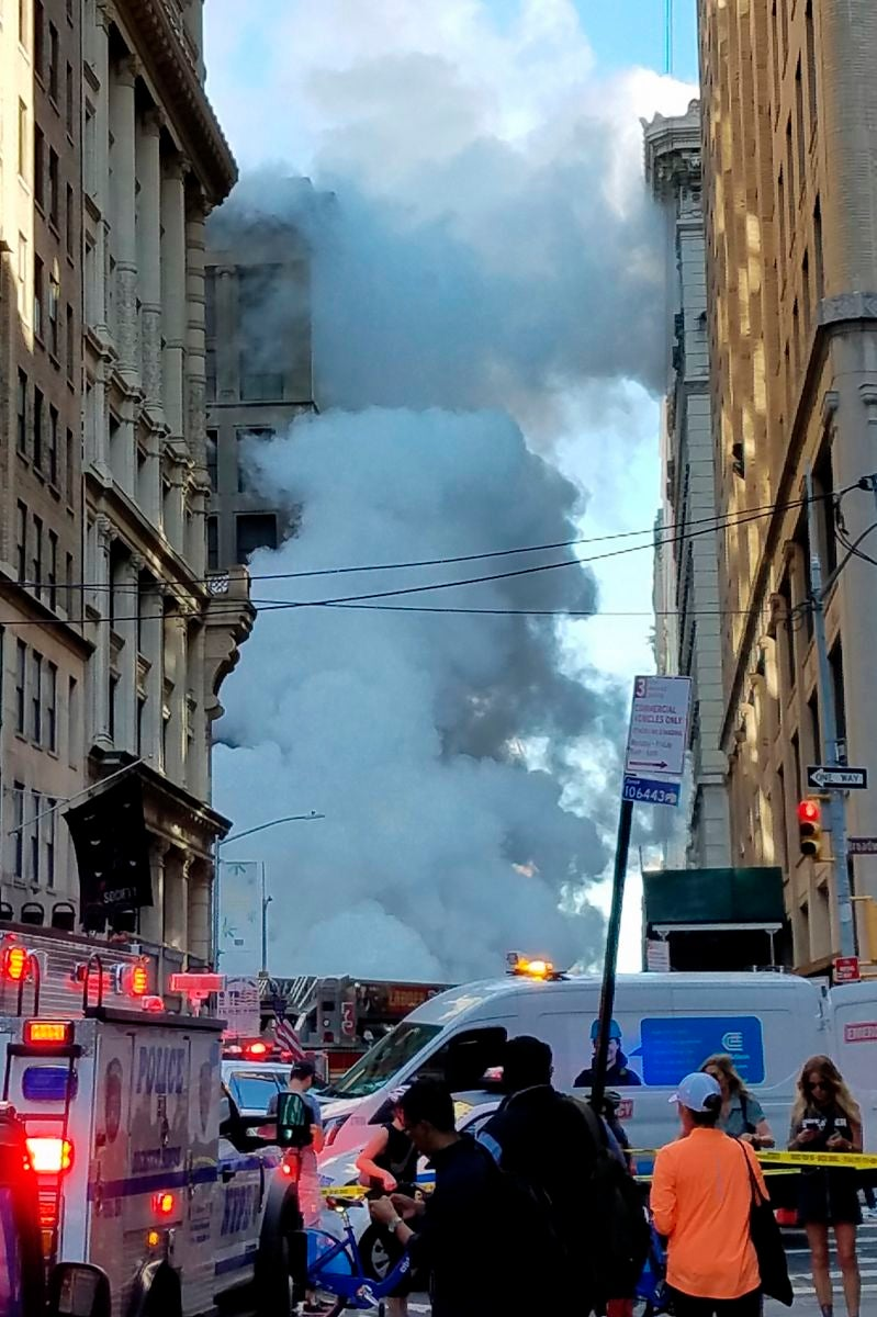 Steam billows on New York's Fifth Avenue, Thursday, July 19, 2018. A steam pipe exploded beneath Fifth Avenue in Manhattan early Thursday, sending chunks of asphalt flying, a geyser of billowing white steam stories into the air, and forcing pedestrians to take cover. (AP Photo/Joyce M. Rosenberg)