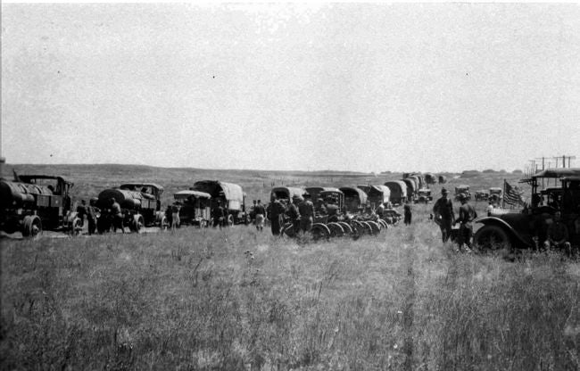 A 1919 convoy halted at a rest stop between Ogalala and Big Springs, Neb. Eighty years ago this summer, a transcontinental army convoy trekked across the country. The trip helped to influence the construction of the interstate highway system. Back in 1919, it took the 280 men and 72 vehicles two months to travel from Washington D.C. to San Francisco, mostly along the often-rugged chain of roads known as the Lincoln Highway. (AP Photo/The National Archives)