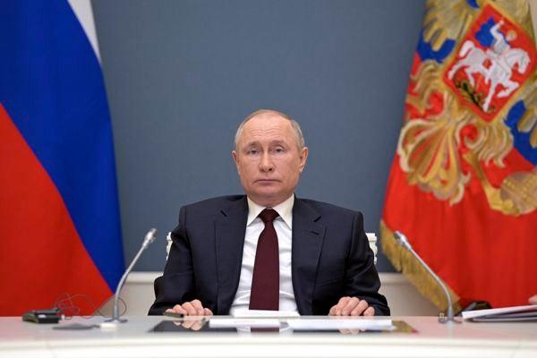 Russian President Vladimir Putin prepares to attend the virtual Leaders Summit on Climate in Moscow, Russia, Thursday, April 22, 2021. (Alexei Druzhinin, Sputnik, Kremlin Pool Photo via AP)