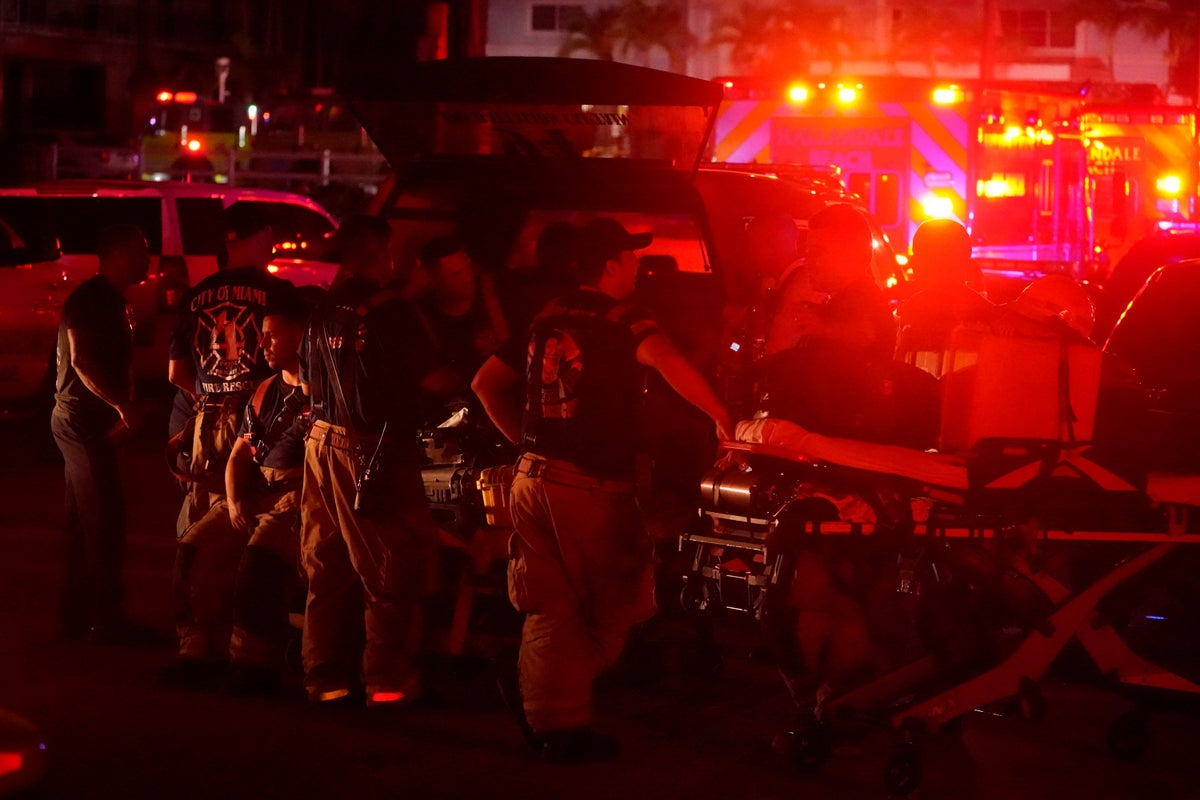 Firefighters standby after a partial collapse of a building, Thursday, June 24, 2021, in the Surfside area of Miami, Fla. A partial building collapse in Miami caused a massive response early Thursday from Miami Dade Fire Rescue, according to a tweet from the department's account.(AP Photo/Wilfredo Lee)