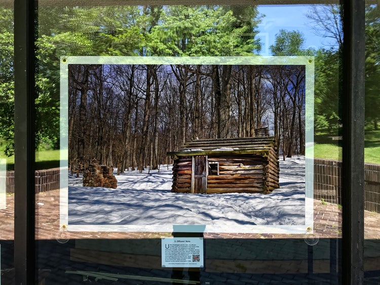 A photograph of Morristown soldier huts by Xiomaro. It is displayed facing outward from the visitor center to encourage outdoor viewing with social distancing. (Photo credit: Xiomaro)