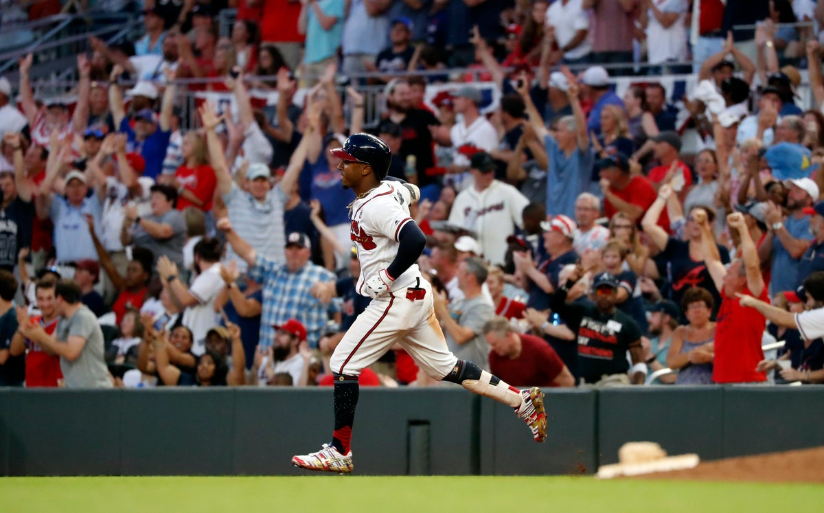 In this July 4, 2019, file photo, Atlanta Braves' Ozzie Albies rounds first base after hitting a three-run home run during the third inning of the team's baseball game against the Philadelphia Phillies in Atlanta. (AP Photo/John Bazemore, File)
